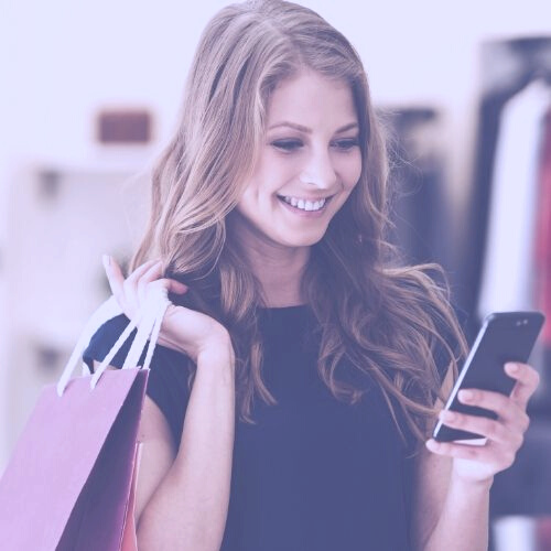 Woman shopping using mobile phone app
